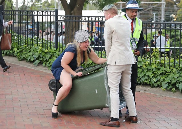 A racegoers walks into a rubbish bin following 2016 Melbourne Cup Day at Flemington Racecourse on November 1, 2016 in Melbourne, Australia. (Photo by Scott Barbour/Getty Images)