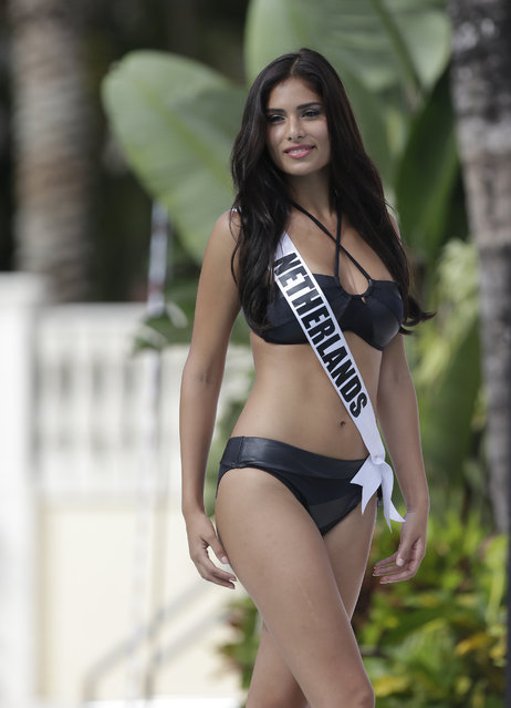 Miss Universe contestant Yasmin Verheijen, of the Netherlands, walks along the pool during the  Yamamay swimsuit runway show, Wednesday, January 14, 2015, in Doral, Fla. (Photo by Lynne Sladky/AP Photo)