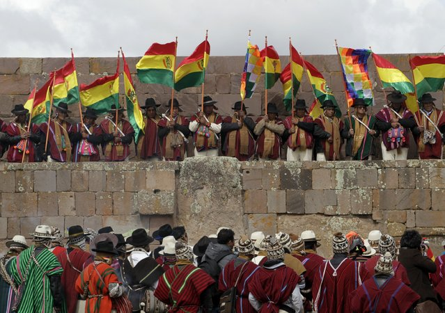 Aymara indigenous people attend an Andean ceremony with Bolivia's President Evo Morales (not pictured) in Tiahuanaco some 70 km from La Paz, January 21, 2015. (Photo by David Mercado/Reuters)