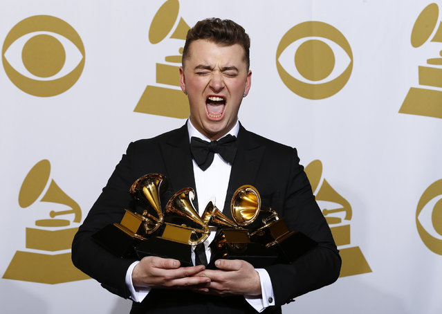 """Sam Smith poses with his awards for Best New Artist, Best Pop/Vocal Album for """"In the Lonely Hour"""" and Song of the Year and Record of the Year for """"Stay With Me"""" in the press room at the 57th annual Grammy Awards in Los Angeles, February 8, 2015. (Photo by Mike Blake/Reuters)"""