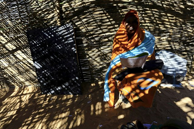 An internally displaced school teacher conducts class inside a makeshift bamboo structure at the El Geneina camp in West Darfur, Sudan, November 24, 2015. (Photo by Mohamed Nureldin Abdallah/Reuters)