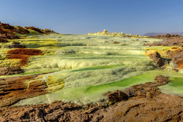 The Danakil Desert stretches over 100,000 square kilometers in three countries: northeast Ethiopia, southern Eritrea and northwestern Djibouti. (Photo by Neta Dekel/Caters News Agency)