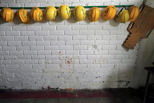 Helmets hang in the room where 14-year-old volunteer Erick Beltran was killed at the Comandos de Salvamento base in Quezaltepeque, El Salvador June 5, 2016. Beltran was the first volunteer to be killed on duty in 56 years of CDS. (Photo by Jose Cabezas/Reuters)