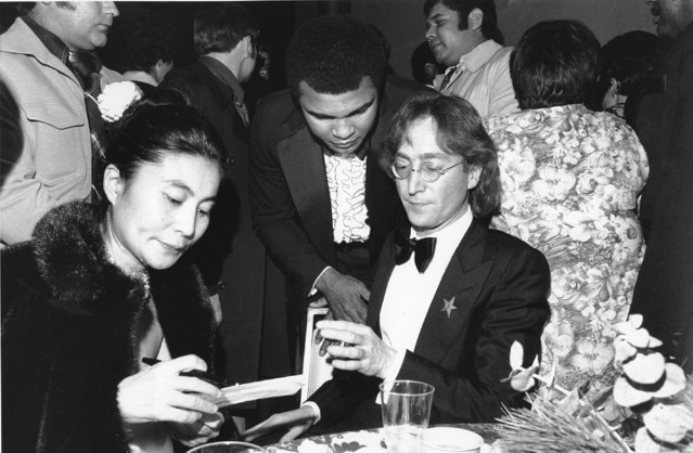 John Lennon and his wife, Yoko Ono, left, are shown with heavyweight boxer Muhammad Ali, center, at the Kennedy Center for the Performing Arts in Washington, D.C., on Januaary 20, 1977. They are at the gala honoring President-elect Jimmy Carter on the eve of his inauguration. (Photo by AP Photo)