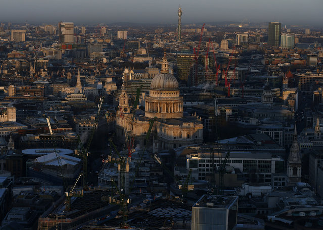 St Paul's Cathedral is seen at sunrise from the Sky Garden of 20 Fenchurch Street, nicknamed the Walkie-Talkie building, in the financial district of the City of London, February 19, 2016. (Photo by Eddie Keogh/Reuters)