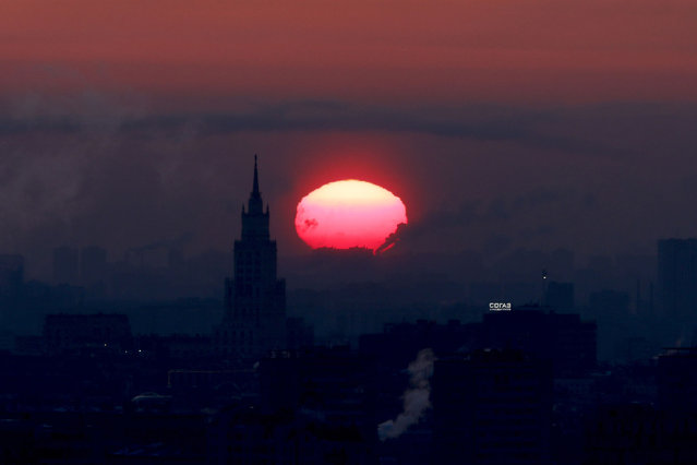 Sun rises over Moscow as temperature dropped to minus 21 degrees Celsius in Russia on March 10, 2021. (Photo by Sefa Karacan/Anadolu Agency via Getty Images)