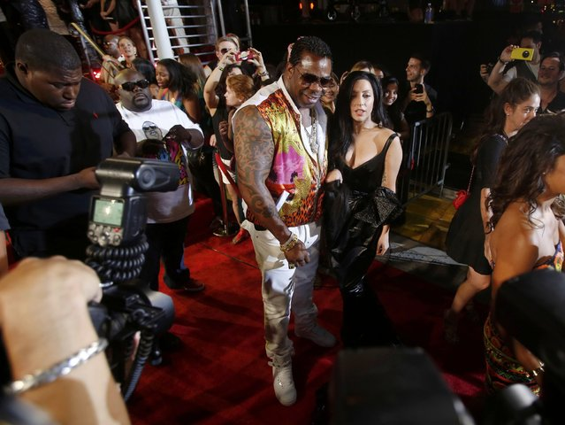 Stefani Germanotta, better known as Lady Gaga, poses with rap artist Busta Rhymes as they arrive for the 2013 MTV Video Music Awards in New York August 25, 2013. (Photo by Carlo Allegri/Reuters)