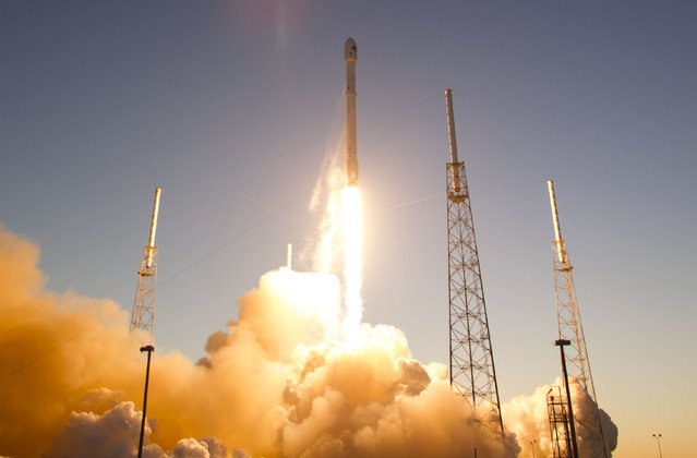 The unmanned Falcon 9 rocket, launched by SpaceX and carrying NOAA's Deep Space Climate Observatory Satellite, lifts off from launch pad 40 the Cape Canaveral Air Force Station in Cape Canaveral, Florida February 11, 2015. (Photo by Scott Audette/Reuters)