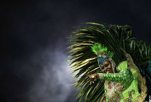 A reveller from the Mancha Verde Samba School takes part in a carnival at Anhembi Sambadrome in Sao Paulo February 13, 2015. (Photo by Nacho Doce/Reuters)