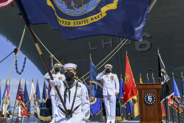 This photo provided by the U.S. Navy shows Rear Adm. Philip Sobeck, Commander, Expeditionary Strike Group Three, and Capt. G. S. Thoroman, commanding officer, amphibious assault ship USS Bonhomme Richard, salute the ensign for colors during a decommissioning ceremony at Naval Base San Diego April 14, 2021. The U.S. Navy has decommissioned the USS Bonhomme Richard docked off San Diego nine months after flames engulfed it in one of the worst U.S. warship fires outside of combat in recent memory. The ceremony Wednesday at Naval Base San Diego was not public with the Navy citing concerns over the spread of the coronavirus. (Photo by Mass Communication Specialist 2nd Class Alex Millar/U.S. Navy via AP Photo)