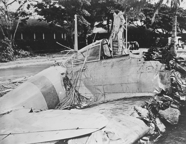 A Japanese Type 00 (Zero) fighter with markings from the carrier Akagi is seen after it crashed during the attack at Fort Kamehameha, near Pearl Harbor, Hawaii, U.S. December 7, 1941. (Photo by Reuters/U.S. Navy/National Archives)