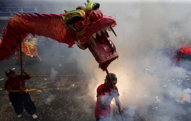 Revellers explode firecrackers as they celebrate Lunar New Year at Manila's Chinatown February 19, 2015. (Photo by Erik De Castro/Reuters)