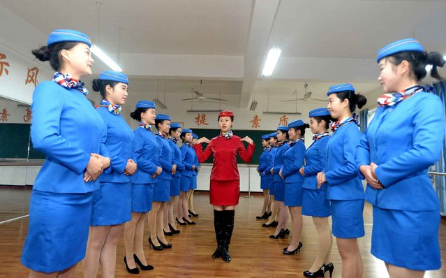 Students exercise in body training at Bishan Vocational Education Center in Chongqing, southwest China, January 13, 2016. These students were trained to be stewardesses of the high-speed train. (Photo by Xie Jie/Xinhua)