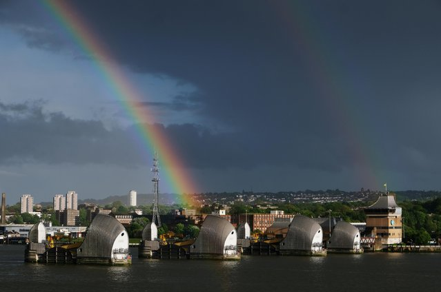 A rainbow is seen over the Thames Barrier on the River Thames while the spread of the coronavirus disease (COVID-19) continues, London, Britain, April 30, 2020. (Photo by Steven Watt/Reuters)