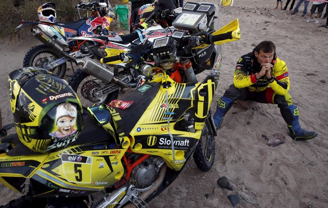 Stefan Svitko of Slovakia sits next to his KTM before the start of the 10th stage of the Dakar Rally 2016 near Fiambala, Argentina, January 13, 2016. (Photo by Marcos Brindicci/Reuters)