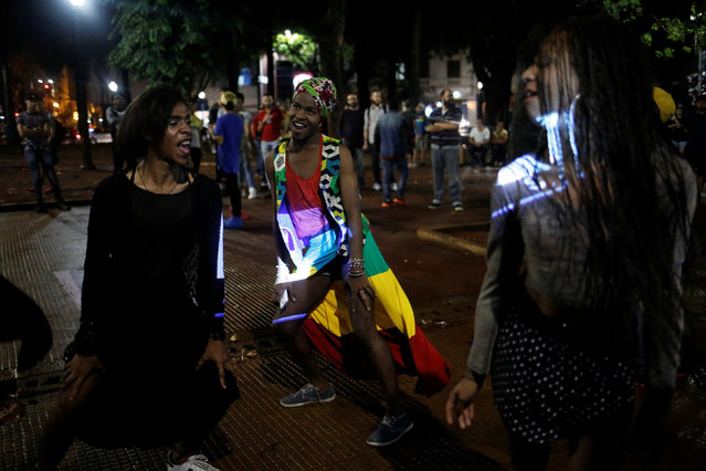 Gaby (L), 18, Vitor (C), 21, and Pamela, who are among members of lesbian, gay, bisexual and transgender (LGBT) community, dance during an event of Arouchianos collective project at Arouche Square in downtown Sao Paulo, Brazil, November 6, 2016. (Photo by Nacho Doce/Reuters)