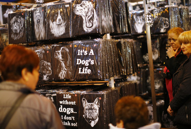 Women look at t-shirts during the first day of the Crufts Dog Show in Birmingham, central England, March 5, 2015. (REUTERS/Darren Staples)