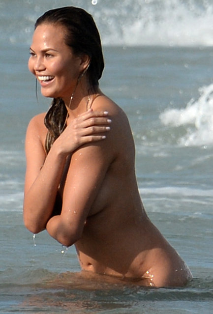Supermodel Chrissy Teigen and singer husband John Legend are seen indulging in some PDA during a photo shoot with photographer Bruce Weber in Miami, FL., on March 12, 2015. After the couple was done posing together, Chrissy was seen dropping her robe and going completely nude into the ocean and frolicking in the waves before the photo shoot wrapped.  Pictured here: Chrissy Teigan. (Photo by Bruce Weber/INFphoto.com)