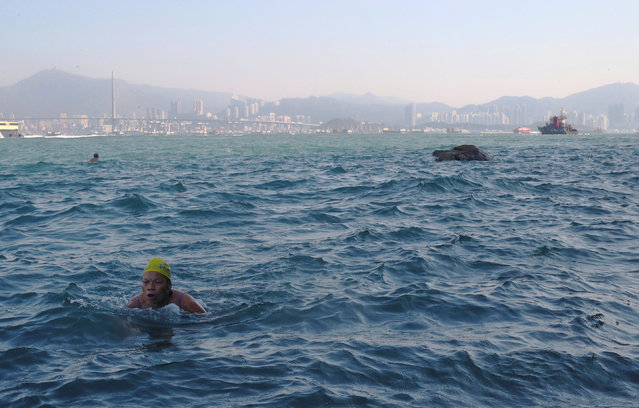 Miao Rong Lu, 68, swims in the sea at the Sai Wan Swimming Shed in Hong Kong, China, October 5, 2018. Rong Lu said she has been coming to the swimming shed for 30 years. (Photo by Hannah McKay/Reuters)