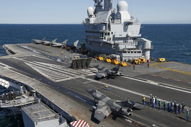 A Super Etendard prepares for a catapult take off from France's Charles de Gaulle aircraft carrier on mission in the Gulf, January 28, 2016. (Photo by Philippe Wojazer/Reuters)