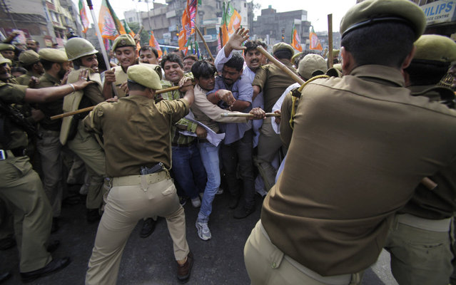 Activists of Bharatiya Janta Party (BJP) scuffle with police as they try to march to the Jammu and Kashmir Civil Secretariat during a protest in Jammu, India, Monday, November 4, 2013. The BJP was protesting against what they called the state government's pro-separatist policy, corruption and mis-governance. (Photo by Channi Anand/AP Photo)