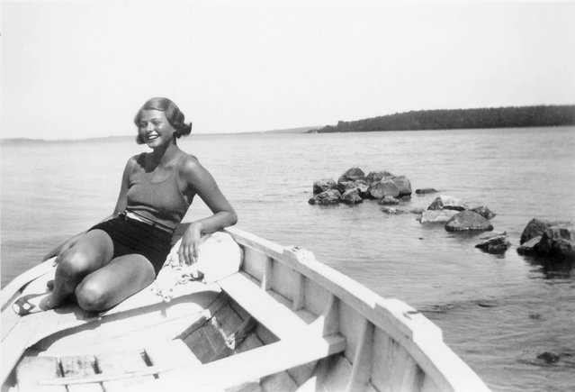 Ingrid Bergman sunbathing in a boat on Lake Mälaren just outside Stockholm, circa 1932, when Bergman was around 18. (Photo by Ingrid Bergman Collection/Wesleyan University)