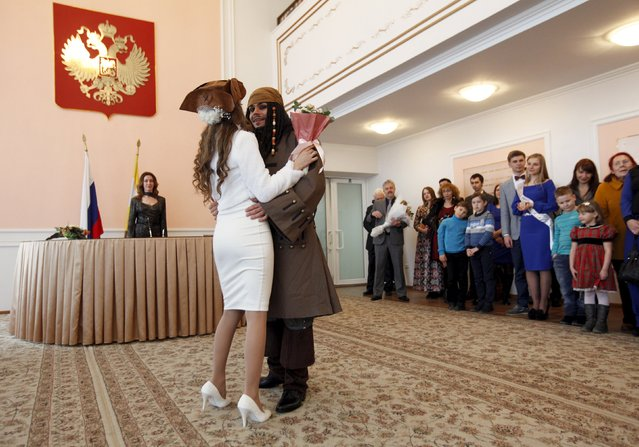 German Yesakov, 25, a cameraman from Russia, dressed as movie character Captain Jack Sparrow, and his bride Anastasiya dance during their wedding ceremony at a registry office in the southern city of Stavropol, Russia, February 5, 2016. (Photo by Eduard Korniyenko/Reuters)