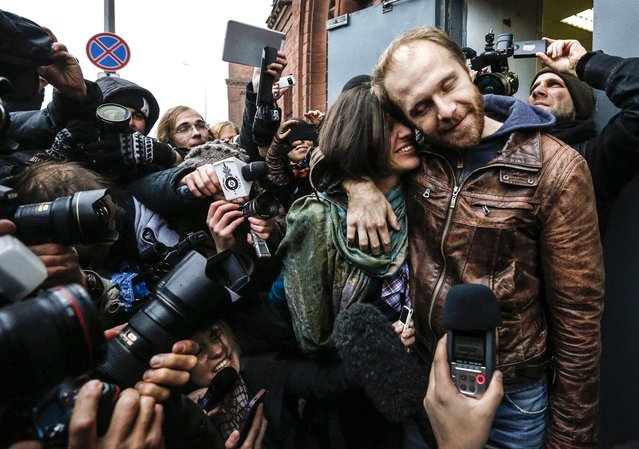 Photographer Denis Sinyakov of Russia embraces his wife Alina after being released from prison in St. Petersburg, on November 21, 2013. Twenty of those detained on September 18 by Russian coast guards during a Greenpeace protest against Arctic oil drilling have now been granted bail this week. (Photo by Alexander Demianchuk/Reuters)