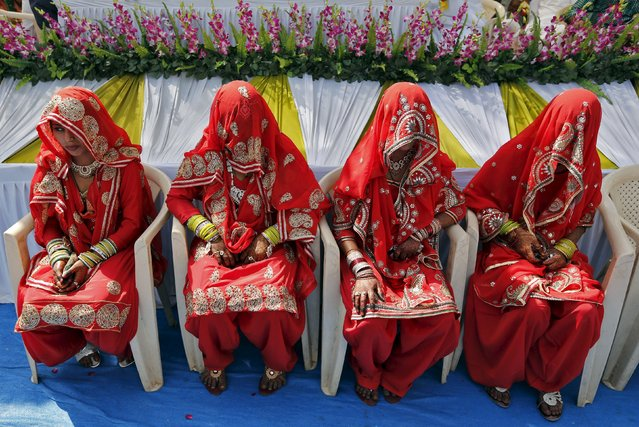 Muslim brides sit as they wait for the start of a mass marriage ceremony in the western Indian city of Ahmedabad March 21, 2015. (Photo by Amit Dave/Reuters)