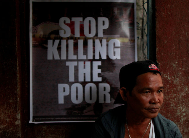A grieving relative attends the wake of Jonel Segovia, 15, who was shot dead by suspected vigilantes at a house storing illegal narcotics, police said on Thursday, in Caloocan city, Metro Manila, December 31, 2016. (Photo by Czar Dancel/Reuters)
