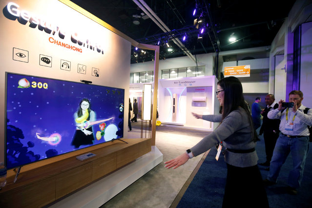 Hongyan Wu of China plays a game on a Changhong television with gesture control during the 2017 CES in Las Vegas, Nevada January 5, 2017. (Photo by Steve Marcus/Reuters)