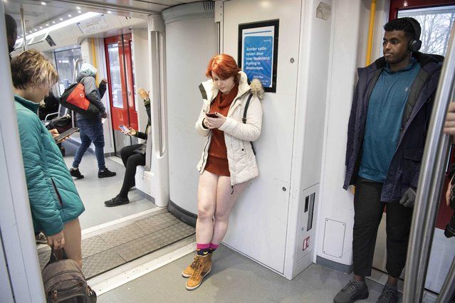 Passengers wear no trousers during the No Pants Subway Ride in Amsterdam, The Netherlands, 13 January 2019. (Photo by Olaf Kraak/EPA/EFE/Rex Features/Shutterstock)