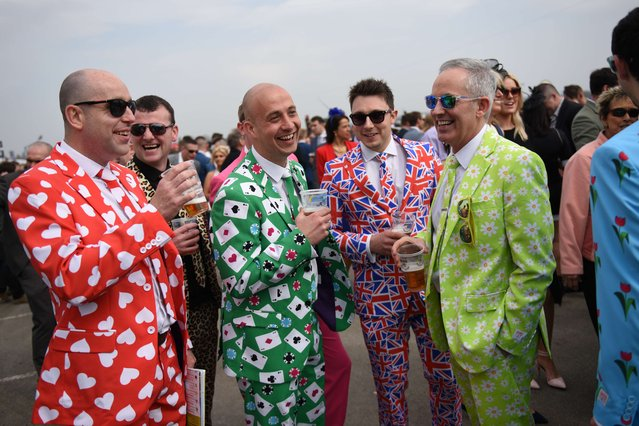 """Racegoers attend """"Ladies Day"""" of the Grand National Festival horse race meeting at Aintree Racecourse in Liverpool, Northern England on April 10, 2015. The annual three day meeting culminates in the Grand National which is run over a distance of four miles and four furlongs (7,242 metres), and is the biggest betting race in the United Kingdom. (Photo by Oli Scarff/AFP Photo)"""