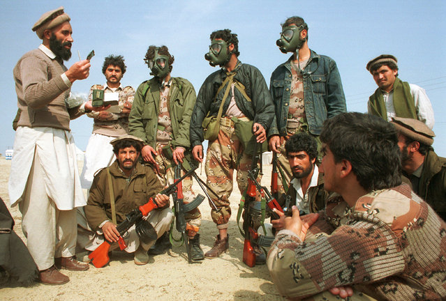 In this February 20, 1991 file photo, some Afghan mujahedeen receive training for possible gas warfare during the Gulf War at their camp in Khafji near the Saudi-Kuwait border. Twenty five years after the first U.S. Marines swept across the border into Kuwait in the 1991 Gulf War, American forces find themselves battling the extremist Islamic State group, born out of al-Qaida, in the splintered territories of Iraq and Syria. The Arab allies that joined the 1991 coalition are fighting their own conflicts both at home and abroad, as Iran vies for greater regional power following a nuclear deal with world powers. (Photo by AP Photo)