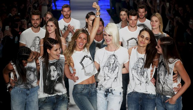 Model Gisele Bundchen reacts as she and other models present creations from the Colcci Summer 2016 collection during Sao Paulo Fashion Week in Sao Paulo April 15, 2015. (Photo by Paulo Whitaker/Reuters)