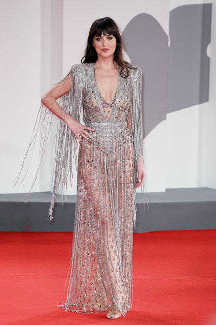 """American actress and model Dakota Johnson attends the red carpet of the movie """"The Lost Daughter"""" during the 78th Venice International Film Festival on September 03, 2021 in Venice, Italy. (Photo by Ernesto Ruscio/Getty Images)"""