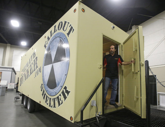 Mike Peters, with Ultimate Bunker stands at the doorway of a 100% steel underground bunker during the PrepperCon expo Friday, April 24, 2015, in Sandy, Utah. (Photo by Rick Bowmer/AP Photo)