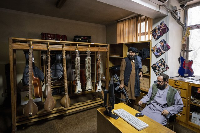 Fighters from the Haqqani network appear inside a room of the Afghanistan National Institute of Music in Kabul, Afghanistan, Thursday, September 16, 2021. The institute was once famous for its inclusiveness and emerged as the face of a new Afghanistan. Now, it is guarded by fighters from the Haqqani network, an ally of the Taliban considered a terrorist group by the United States. (Photo by Bernat Armangue/AP Photo)