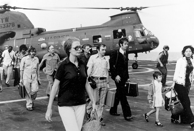 In this Tuesday, April 29, 1975 file photo, American citizens arrive aboard the command and control ship USS Blue Ridge after being evacuated out of Saigon, South Vietnam, by U.S. Marine and Air Force helicopters operating from Navy ships. (Photo by AP Photo/U.S. Navy)