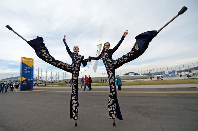 Performers pose for a picture at the Olympic Park during the 2014 Sochi Winter Olympics on February 14, 2014. (Photo by Andrej Isakovic/AFP Photo)