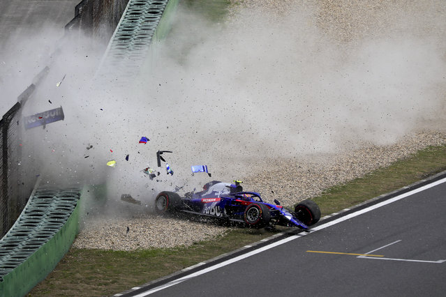 In this photo provided by Cheung Yuk Ling, Toro Rosso driver Alexander Albon of Thailand crashes his car during the third practice session for the Chinese Formula One Grand Prix at the Shanghai International Circuit in Shanghai, China, Saturday, April 13, 2019. (Photo by Cheung Yuk Ling via AP Photo)