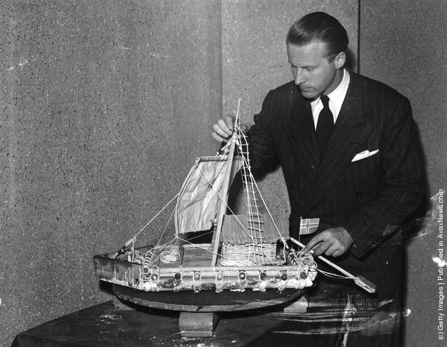 Thor Heyerdahl with a model of the balsa raft Kon Tiki