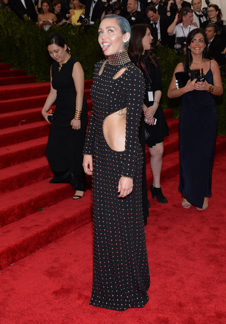 "Miley Cyrus arrives at The Metropolitan Museum of Art's Costume Institute benefit gala celebrating ""China: Through the Looking Glass"" on Monday, May 4, 2015, in New York. (Photo by Evan Agostini/Invision/AP Photo)"