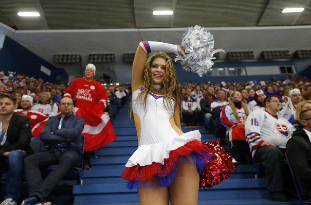A cheerleader performs as fans watch the Ice Hockey World Championship game between Slovakia and Denmark at the CEZ arena in Ostrava, Czech Republic May 2, 2015. (Photo by Laszlo Balogh/Reuters)