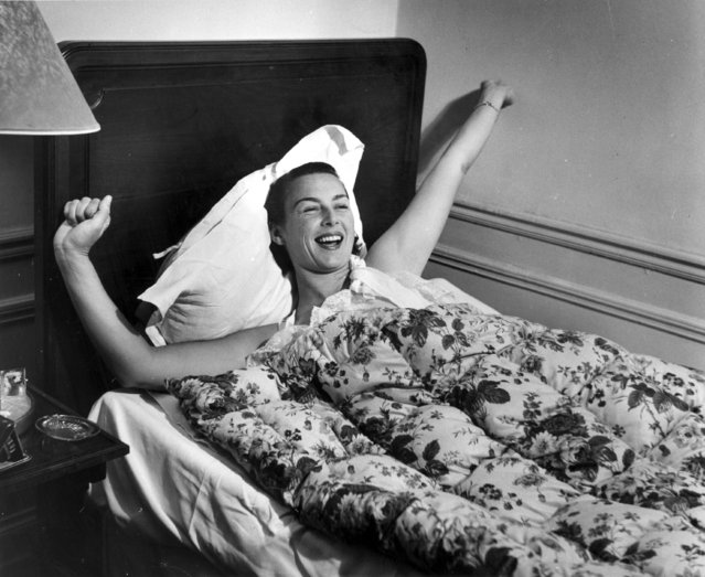 American tennis player Gertrude Moran, or Gorgeous Gussie, waking up in her Paris hotel room, 3rd June 1950 (Photo by Bert Hardy/Picture Post/Getty Images)
