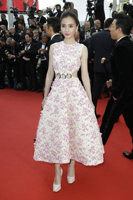 Angelababy arrives for the opening ceremony and the screening of the film La Tete Haute (Standing Tall) at the 68th international film festival, Cannes, southern France, Wednesday, May 13, 2015. (Photo by Joel Ryan/Invision/AP Photo)