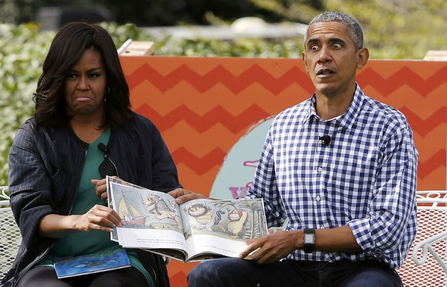 """First lady Michelle Obama and President Barack Obama perform a reading of the children's book """"Where the Wild Things Are"""" for children gathered for  the annual White House Easter Egg Roll on the South Lawn of the White House in Washington, March 28, 2016. (Photo by Jonathan Ernst/Reuters)"""
