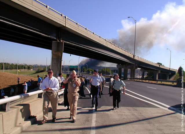 Military personnel move down highway I-395 while evacuating the Pentagon September 11, 2001