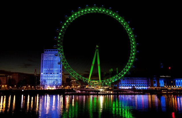 The EDF London Eye in central London is lit green by Tourism Ireland to celebrate St Patrick's Day which is on Monday 17th. (Photo by David Parry/PA Wire)