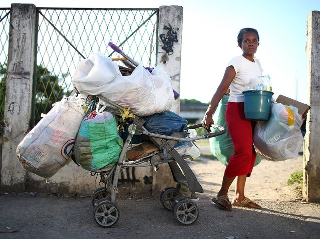 Resident and refuse picker, or catadora, Dona Lucinda, works in the slum complex. (Photo by Mario Tama/Getty Images)